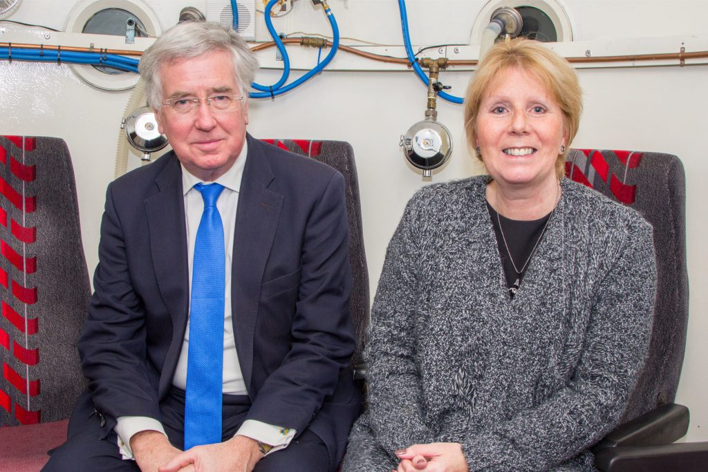 Michael Fallon MP inside the oxygen therapy chamber with manager Deborah Clarke