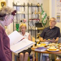 Poet Lynne Nesbit reads her poetry during a lunch at Swanley Therapy Centre.