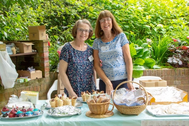 Volunteers Christine and Anne-Marie on the cake stall