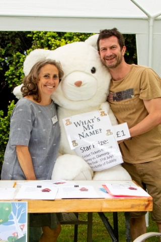 Volunteers Laura & Tim with Name the Teddy